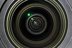 Photographic lens closeup view with light reflections Stock Photos