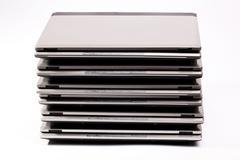 organized pile of laptops - stock photo