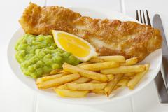 fish and chips with mushy peas - stock photo