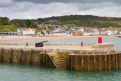 Lyme Regis harbour wall  Dorset, England from the Cobb - stock photo