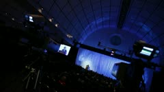 Convention hall speaker dutch angle Stock Footage