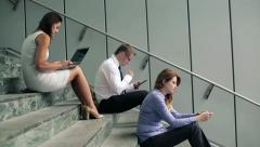 Young business people working on stairs by office building HD - stock footage