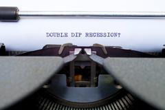 double dip recession typed on an old typewriter - stock photo