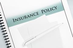 insurance policy document booklet brochure paperwork - stock photo