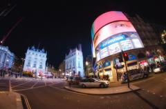 london,nov 27: famous piccadilly circus neon signage shines at night. these s - stock photo