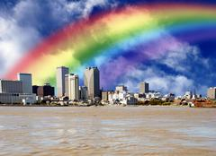 Rainbow over the city with skyscrapers and river Stock Photos