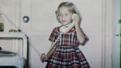 Little GIRL ON THE PHONE to Daddy 1950s Vintage Old Retro Film Home Movie 4873 - stock footage