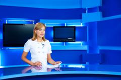 television newscaster at tv studio - stock photo