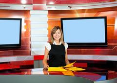 Stock Photo of television anchorwoman at tv studio