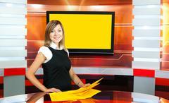 Pregnant television anchorwoman at tv studio Stock Photos