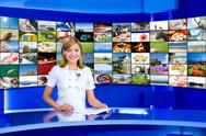 Stock Photo of television anchorwoman at tv studio