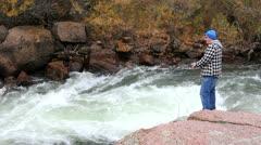 High angle of young man fishing. Stock Footage