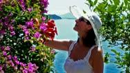 Woman in a summer garden Stock Footage