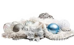 Christmas composition with blue ball and silver flower on white Stock Photos