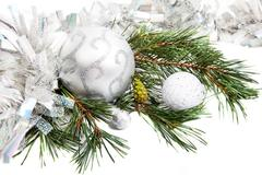 new year composition with fir branch, tinsel and balls - stock photo