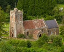 Compron Bishop church Somerset from Crook Peak - stock photo