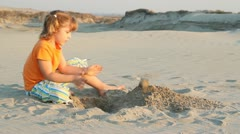 Little girl play in sand Stock Footage