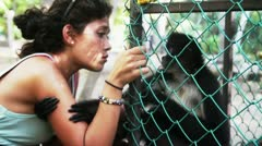 Girl Embracing Monkey caged Stock Footage