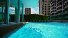 Pool on condominium roof, bangkok, slow-motion Stock Footage