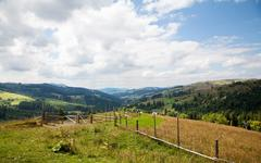 fense in the meadow - stock photo