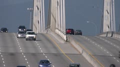Freeway traffic over Pitt River Bridge, very long shot Stock Footage