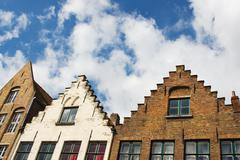 Facade of flemish houses in brugge, belgium Stock Photos