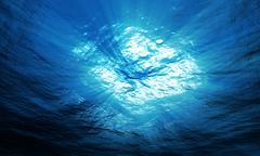 Light underwater in ocean Stock Photos