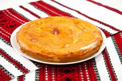 onion pie on traditional ukrainian towel - stock photo