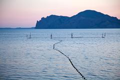 purple sunset on black sea - stock photo