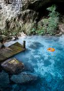 blue lake with orange life buoy - stock photo