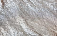 Shiny silver fabric taffeta background Stock Photos
