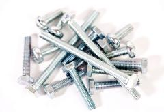 bolts and hobnails on white background - stock photo