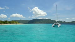 Tropical sailboat and island at Sandy Cay, British Virgin Islands Stock Footage