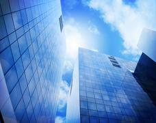 Bright Blue City Buildings with Clouds - stock illustration