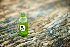 Green glass bottle from poison Stock Photos