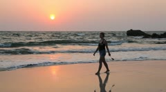 Young woman walk Ngapali beach during sunset, Myanmar Stock Footage