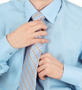 Business man adjust beautiful new tie Stock Photos