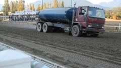 Water truck prepares the track. Stock Footage