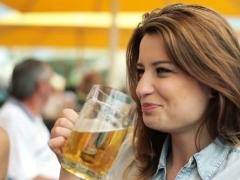 Woman drinking beer and chatting in bar, steadicam shot NTSC Stock Footage