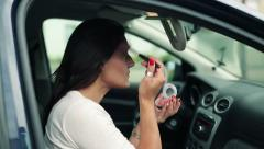 Woman applying beauty make-up in the car, steadicam shot HD - stock footage