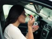 Stock Video Footage of Woman applying beauty make-up in the car, steadicam shot NTSC