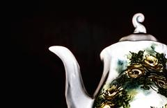 Teapot in a dark background Stock Photos