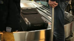 Collecting luggage in the baggage claim on an airport Stock Footage