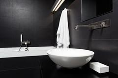 Modern minimalism style bathroom interior in black and white tones Stock Photos