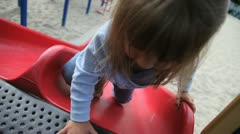 Kid climbs slide Stock Footage