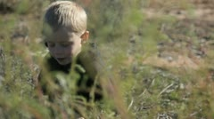 boy in weeds 4 - stock footage