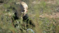 boy in weeds 3 - stock footage