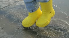 puddle jumping - stock footage