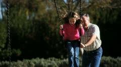 Man Swings Girl - stock footage