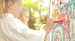 Little girl painting 3 Stock Footage
